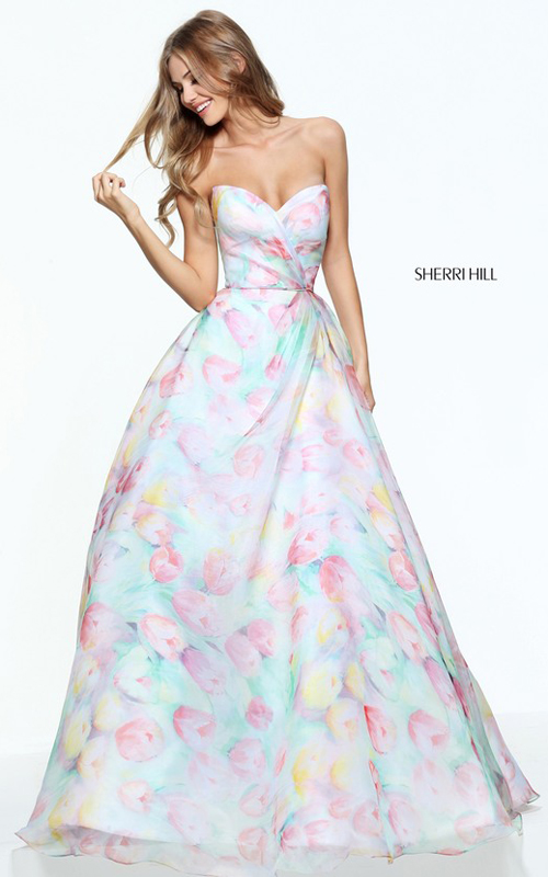 d5130dbbd9 Twirl onto the dance floor wearing this gorgeous printed fabric prom dress  50934 from Sherri Hill for your senior prom. This enchanting gown features  a ...